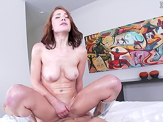 Lubed bitch in silver boots rides cock after partner fucks her on the edge of the bed and from behind