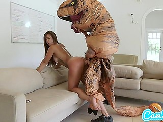Tanned girl on hoverboard tries to run away from big dinosaur but she is caught and treated with strapon
