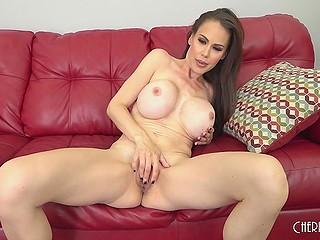 Classy pornstar with round boobs McKenzie Lee performs on couch unforgettable solo masturbation