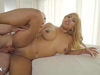 Bald stallion gives great pleasure to staggering Latina with big breasts stretching her ass with big cock