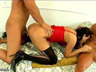 Two excited stallions double penetrate smoking-hot brunette and cover her body with man juice