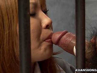 Asian female wants to get out of the prison and she is prepared to give a blowjob to the prison guard