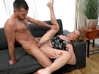 Woman in dress is happy with young lover who practices all the sex types with her