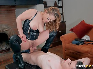 Strong independent woman wearing leather clothes exploits man for her own sexual purposes
