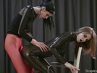 Latex suit has special clasp so that mistress fucks slave without removing her clothes