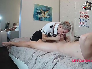 Sexy girl in uniform isn't shy about bestie in the next room and does webcam work with the man