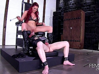 Red-haired mistress Skyla Novea with big boobs uses the slave for her own pleasure