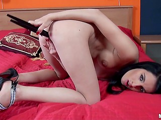 Pussy masturbation is one of the ways for the dark-haired girl with Monroe piercing overcome boredom