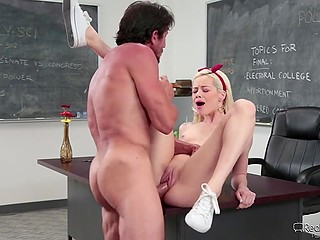 Light-haired college girl with small boobies spreads legs for the politics teacher to have a good grade