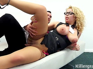 Sex with the co-worker in the office is a good way for the curly blonde with glasses to relieve stress