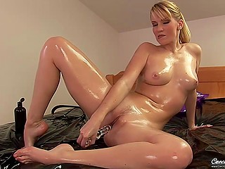 Stunning blonde MILF covers own perfect body with oil before starting to play solo with sex toy