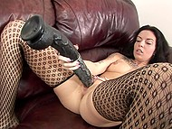 Dark-haired girl in stockings hopes to reach intense orgasm thanks to the huge black dildo