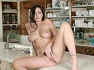 Black-haired girl with great boobs Karlee Grey spontaneously masturbates in the kitchen