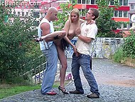 Bald man and friend find a public place where they can practice threesome sex with the bitch in heels