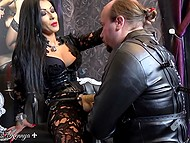 Dark-haired domme receives big pleasure when she watches the submissive with a long tail sucks strapon