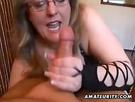 Mature hottie with glasses presents amazing blowjob in the POV scene