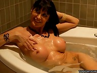 Horny long-haired MILF with nice coconuts presents first-class blowjob her bald dude
