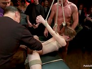 Girl tied to the table gets fucked hard by all the people who was in the bar