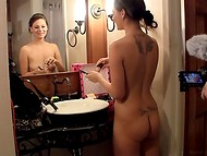 Naughty naked girl preens in the shower in anticipation of a good day